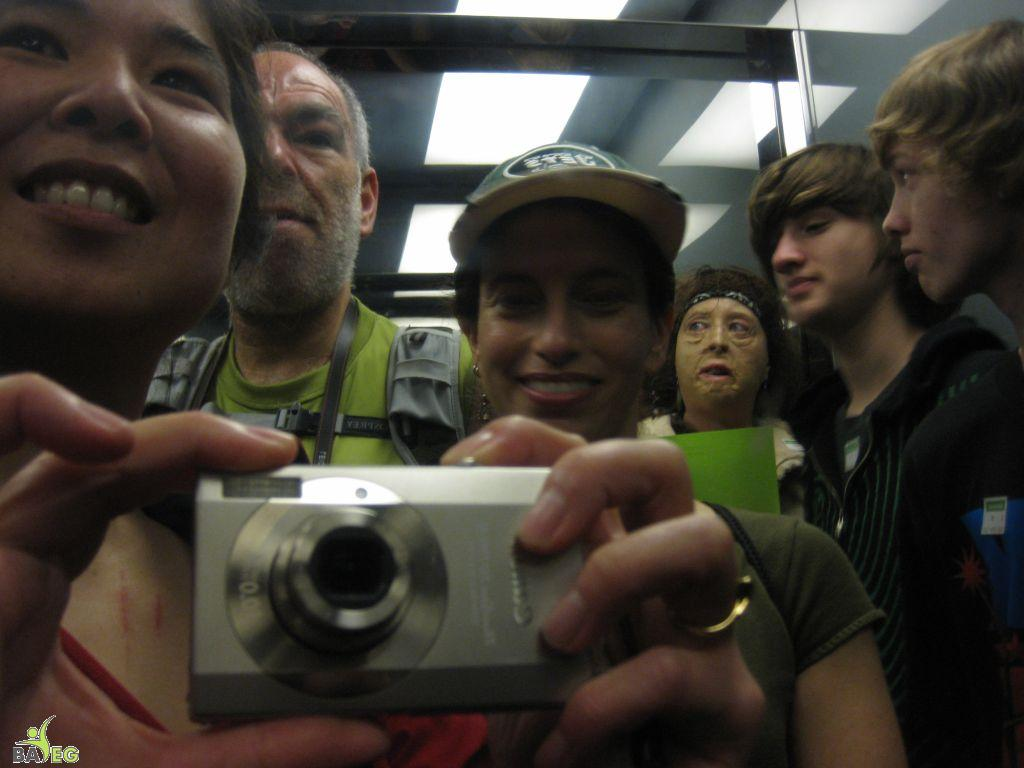 Self-photograph using the shiny interior of the elevator to the tower at Golden Gate Park
