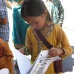 Young reader of PETA's All Animals are Equal at BAVeg booth at the JCNC 10th Anniversary celebration