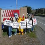 Our costumed chicken urges awareness of KFC's treatment of chickens.