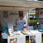 Sunday setup done. Tammy shows off the yummy vegan cookies we were giving away (donated by Sun Flour Baking Company)