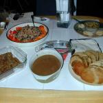 "We feasted on Tofurky, with ""giblet"" gravy, tempeh drumsticks, couscous veg salad with persimmons, the-pate-that-taste"