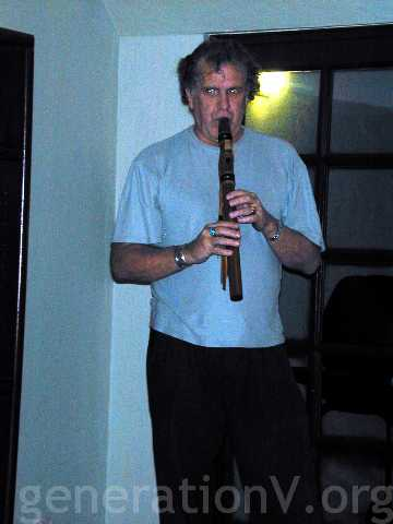 Roy playing a Native American flute.