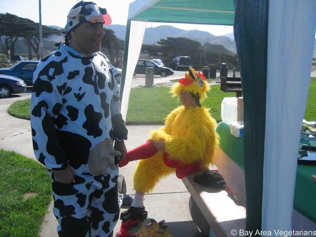 The costumed cow and chicken emerge