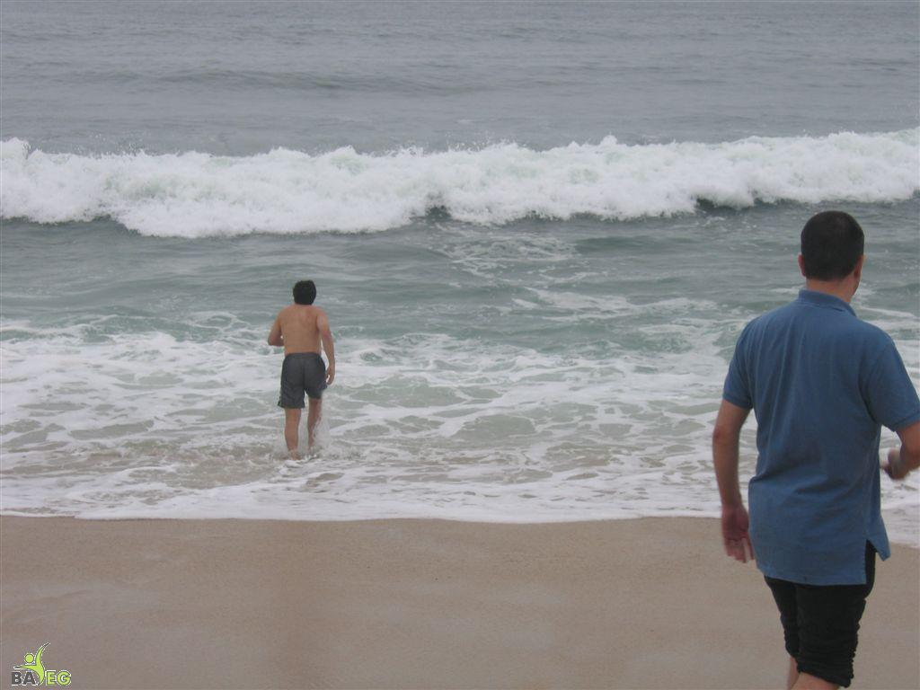 Jon runs into the surf