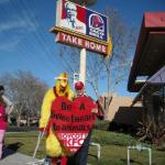 "Mike ""the Chicken Man"" and Carol, event organizer, protest KFC Cruelty"